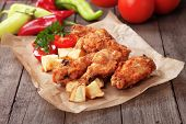 stock photo of southern  - Southern fried chicken wings with spicy potato - JPG