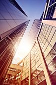 stock photo of frankfurt am main  - modern glass and steel office complex in the sun - JPG