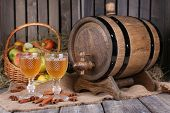 stock photo of cider apples  - Still life with tasty apple cider in barrel and fresh apples - JPG