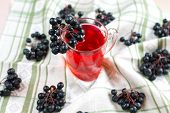image of chokeberry  - Compote of black chokeberry on the table