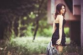 foto of jeans skirt  - Beautiful girl in black skirt holding hands in jeans jacket - JPG