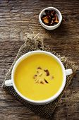 stock photo of chanterelle mushroom  - pumpkin soup with chanterelles on a dark wood background - JPG