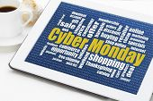pic of monday  - Cyber Monday word cloud  on a digital tablet with a cup of coffee  - JPG