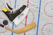 foto of hockey arena  - Hockey skates stick and puck on a hockey rink - JPG