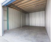 stock photo of roller door  - Empty aluminum single garage with roller door - JPG