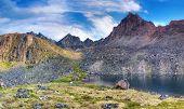 stock photo of siberia  - Deepest lake under the mountain peak - JPG