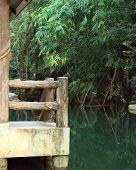 foto of gazebo  - stone gazebo for relaxing by the river in the park - JPG