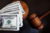 stock photo of court hammer  - A judges court gavel and assorted money - JPG