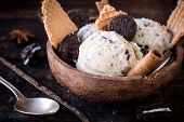 stock photo of ijs  - Stracciatella ice cream and cookies in the wooden bowlselective focus
