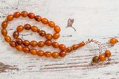 stock photo of rosary  - Traditional rosary from Islamic culture on white wooden background - JPG