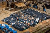 stock photo of toxic substance  - Several barrels of toxic waste at the dump - JPG