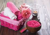 picture of salt-bowl  - Spa setting with sea salt towels and flower on painted wooden boards. Selective focus is on salt in bowl.
