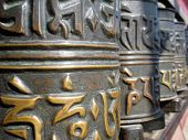 stock photo of tibetan  - A row of Tibetan Buddhist prayer wheels - JPG