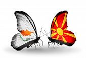 stock photo of macedonia  - Two butterflies with flags on wings as symbol of relations Cyprus and Macedonia - JPG