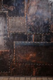 stock photo of rusty-spotted  - Scratched and spotted a rusty metal background - JPG