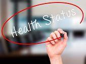 foto of status  - Man hand writing Health Status on visual screen - JPG