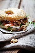 image of bagel  - Homemade bagel filled with goat cheese and tomato - JPG