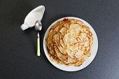 image of frizzle  - Frying homemade pancakes with sour cream on dark table - JPG