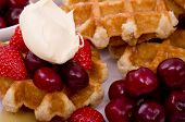 picture of fruit platter  - A pile of Belgian Waffles and fresh summer fruits with maple syrup drizzled on - JPG
