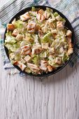 stock photo of caesar salad  - Caesar salad with chicken on the plate - JPG