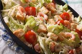 stock photo of caesar salad  - Caesar salad with shrimp and tomatoes close - JPG