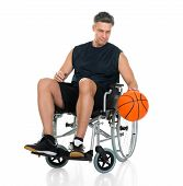 foto of paralympics  - Disabled Player On Wheelchair Holding Basketball Over White Background - JPG