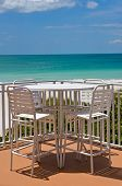 foto of gulf mexico  - Outdoor Table and Chairs on a Patio overlooking white sandy beach on the Gulf of Mexico - JPG