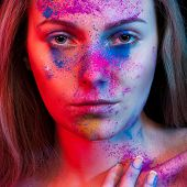 stock photo of face-powder  - Young woman fashion make up and color powder on face - JPG