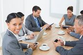 stock photo of indian beautiful people  - Business people in meeting with new technologies at the office - JPG