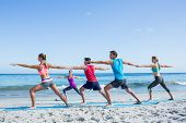 image of teachers  - Friends doing yoga together with their teacher at the beach - JPG
