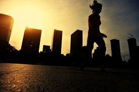 image of skateboard  - silhouette of skateboarder skateboarding at sunrise city - JPG