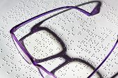 picture of braille  - A pair of glasses and a book in Braille - JPG
