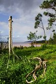 stock photo of driftwood fence  - a rope tied to a fence with a beautifull landscape - JPG