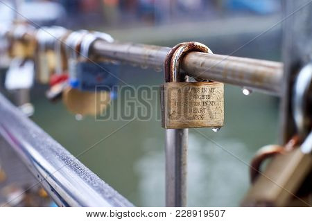 Love Padlocks Attached To The