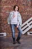 Stylish Model Child. Girl Jeans Clothes. Cute Fashion Kid Model Posing In Casual Jeans Clothes. Beau poster