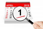 Fools Day Concept. 1 April 2018 Calendar With Magnifier poster