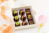 Assortment Of Luxury Bonbons In Gift Box On White Background With Flowers. Exclusive Handmade Chocol poster