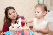 Happy Pregnant Mother And Her Baby Daughter Having Fun And Enjoy Eating At Birthday Party With Birth poster