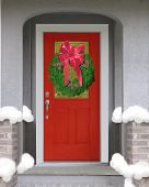 picture of christmas wreath  - Holiday wreath with red bow on Red door - JPG