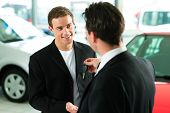 foto of rep  - Man at a car dealership buying an auto - JPG