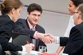 foto of business meetings  - Image of businessmen shaking hands at meeting - JPG