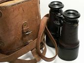 picture of etui  - Old military binoculars with leather case on white background - JPG