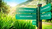 Signpost in the park with conceptual directions, eco friendly, go green, recycle and save earth, con poster
