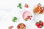 Breakfast With Muesli, Strawberry Smoothie, Waffles, Fruits On White Background. Flat Lay, Top View, poster