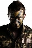 image of army soldier  - young soldier face with jungle camouflage paint on white background - JPG