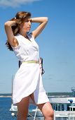 foto of aurochs  - Making look younger girl looks far on background ship and sky - JPG