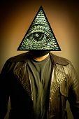 foto of illuminati  - A male figure in a leather trench coat wearing an Illuminati symbol eye of providence or all seeing eye mask - JPG