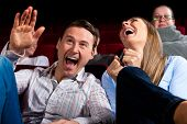 stock photo of watching movie  - Couple and other people - JPG