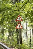 Road Signs By The Road. Two Warning Road Signs Are Installed At The Edge Of The Forest Road. Sunligh poster