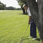 Senior Asian man playing golf